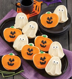 Buttercream Frosted Ghost and Jack O Lantern Cut out Cookies