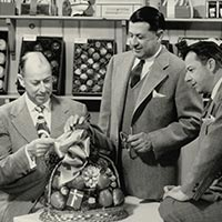 Three Businessmen with Gift