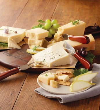 Artisanal Cheeses with Cutting Board and Knives